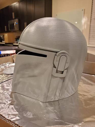 3D Printed Mandalorian Helmet from the Star Wars Disney Plus Series. This work in progress side view image shows the primer down on the raw print.